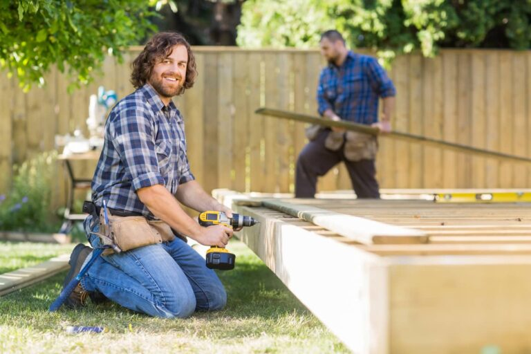 An image of deck and fence contractors putting together a deck.