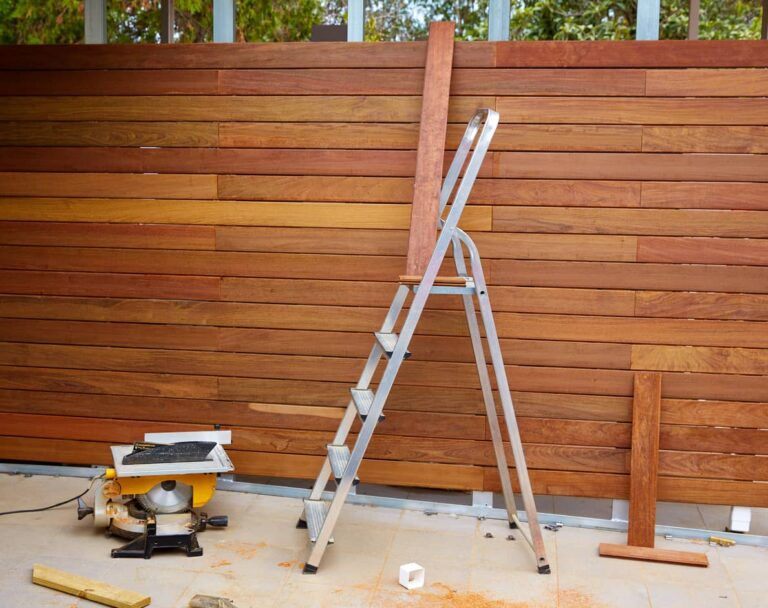 An image of a nearly finished custom wooden fence.