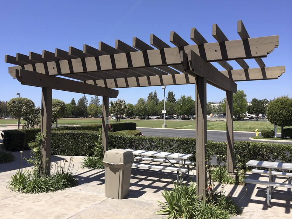 This is an image of a pergola constructed in a large complex.